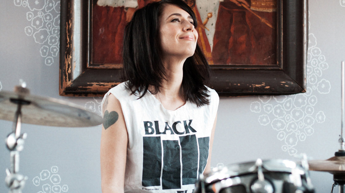 kathleen-hanna-playing-the-drums-photo-courtesy-of-allison-michael-orenstein